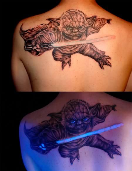 UV Tattoos have always seemed pretty gimmicky to me, until now. Finally a use of the glow in the dark ink that actually makes sense! Done by tattoo artist Kennith Bryan of Intimate Body Art Studios, this is really great work, and I am sure Yoda would approve. In this case, this dedicated Star Wars fan is definitely doing and not trying