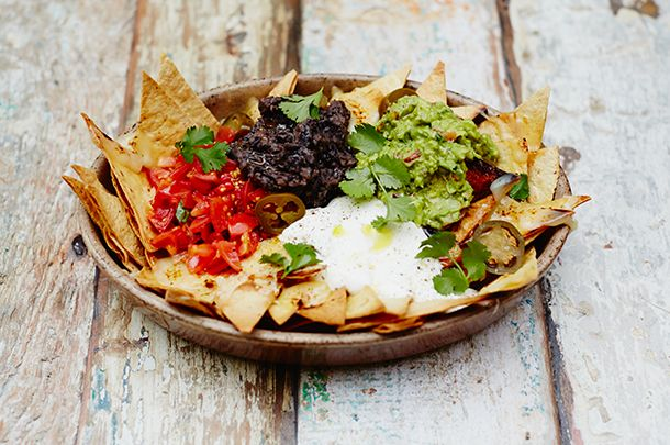 This Super Bowl Sunday, construct the perfect nachos - the beloved Mexican dish of tortilla chips topped by melted cheese, jalapeño peppers, and guacamole.