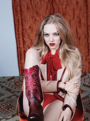 Amanda Seyfried - Prada jacket and top; Eres swimsuit bottoms; Van Cleef & Arpels bracelet; Cartier ring.