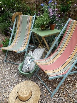 Vintage deck chairs and folding table with chippy paint http://www.uk-rattanfurniture.com/product/pack-of-2-black-water-resistant-fabric-outdoor-garden-circular-bolster-cushion-armrest-pillow-ready-filled/