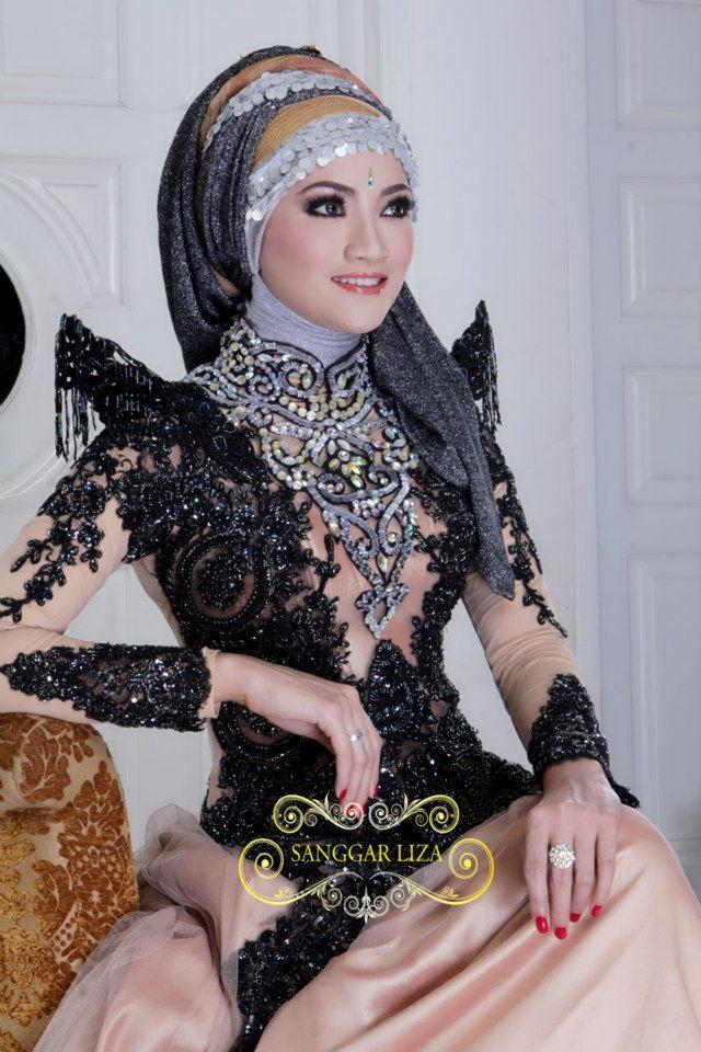 Wow.  Very Disney Villainess. .................. .........................................Kebaya with Hijab