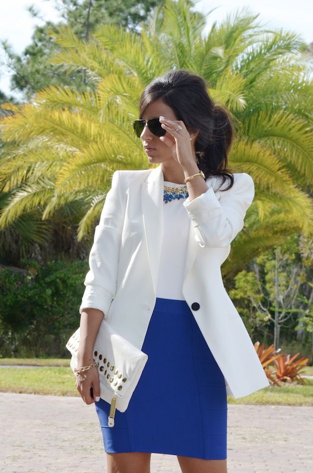 White blazer over white top over blue pencil skirt with sunglasses, clutch and statement necklace.