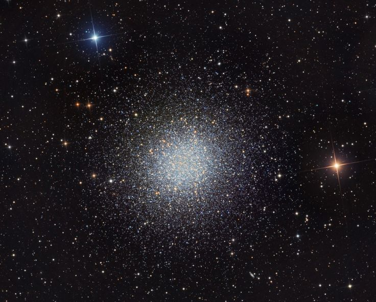 "M13: The Great Globular Cluster in Hercules (June 14 2012)  Image Credit & Copyright: Martin Pugh In 1716, English astronomer Edmond Halley noted, ""This is but a little Patch, but it shews itself to the naked Eye, when the Sky is serene and the Moon absent."" Of course, M13 is now modestly recognized as the Great Globular Cluster in Hercules, one of the brightest globular star clusters in the northern sky. Telescopic views reveal the spectacular cluster's hundreds of thousands of stars…"