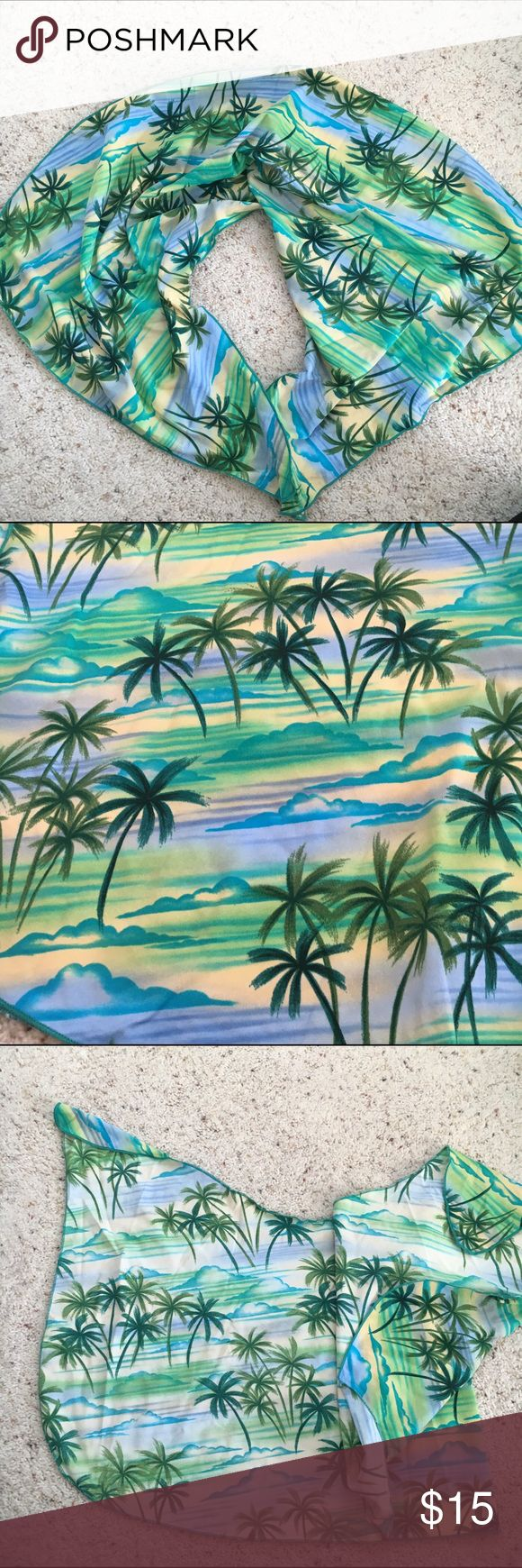 Raisins Sarong Swim Cover Up Skirt Palm Trees Stretchy cover up from Raisins. Sarong style mini skirt. Super cute, comfy and made of a bathing suit material to keep you dry. Green blue and yellow palm tree beach print. Worn only ONCE! Raisins Swim Sarongs