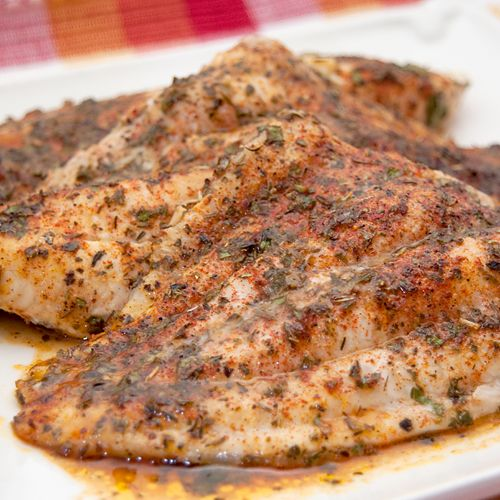 Baked catfish fillets topped with an herb blend, butter and lemon and baked until golden.