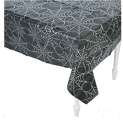 Frightful Fun Table Cover (Plastic).  Decked out in spooky black with silver spider webs, this Frightful Fun Tablecloth is a must have addition to your Halloween party supplies.  Perfect for protecting your table against spills and messy fingers, simply drape it over your table and let the party begin!  It's perfect for the buffet or refreshment table at your Spooky Themed or Halloween party!  Price is per Table Cover; 137 x 275cm. Plastic
