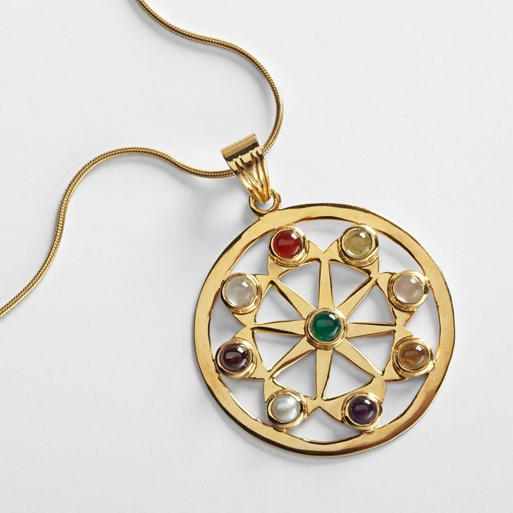 "Jaipur Sun Necklace :: Handcrafted in Jaipur, Rajasthan, India. 22-karat gold-plated sterling silver with amethyst, carnelian, citrine, cultured pearl, garnet, moonstone, peridot, and onyx. Necklace: 16""L, spring ring clasp. Pendant: 1 3/8"" diameter."