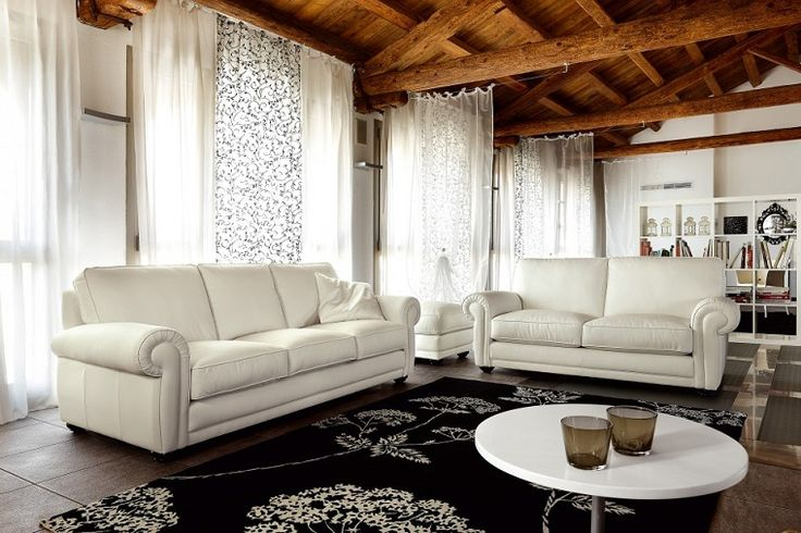White leather couches ... On a side note I love the ceiling in this building too :P