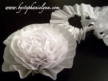Great bridal shower flowers!  Use two rolls of crepe paper for alternating colors!  This is how I made the flowers for Amie House's bridal shower!
