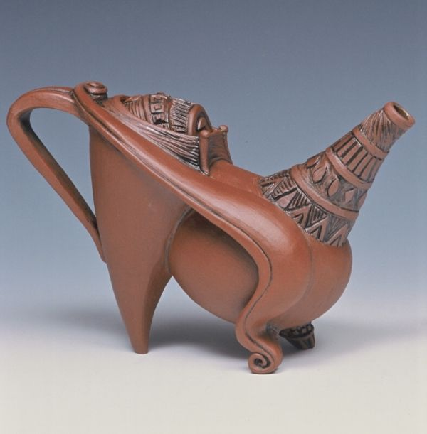 Carol Wedemeyer creates exciting forms and graphic movement in her teapots, cups and pitchers and her sculptural pieces.