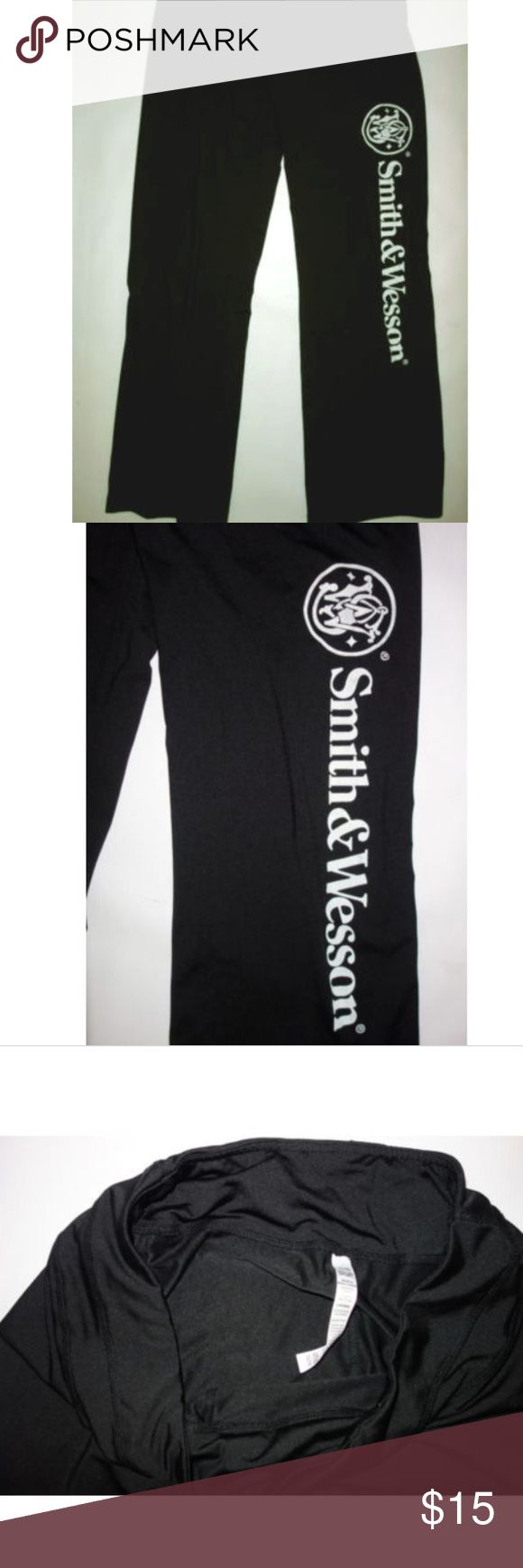 """Smith & Wesson Yoga Pants North End Sport Yoga Athletic Pants Women XL Black Smith & Wesson Logo dst Preowned in excellent condition No rips, tears or stains Black with white lettering on the leg Flat waistband Smith & Wesson down the side of the leg Waist measures 18"""" flat across the front Inseam is 36"""" I have other items like this listed Thank you for looking! North End Pants Track Pants & Joggers"""