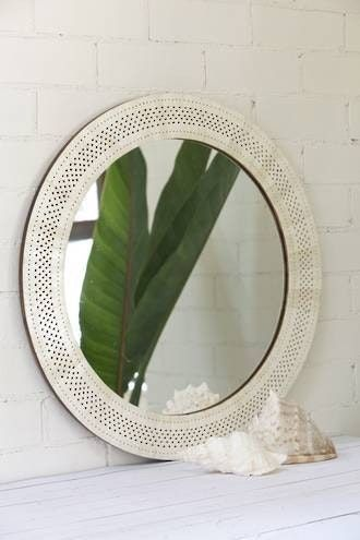 Handcarved bone mirrors add a natural and classic touch to any interior and are beautiful wedding gift idea.Dimensions: 66cm outer diameter. Mirror: 50cm diameter & intricately handcarved border is...