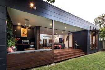 The shallow deck extends the living room to the garden and vastly extends the 190 sq. footprint of this home