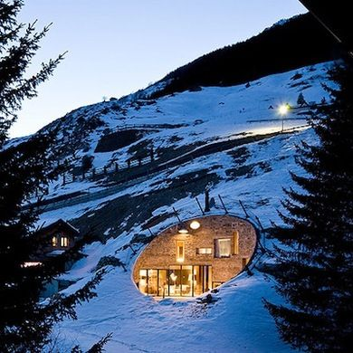 Buried almost completely into the side of a hill, this Alpine home built by a Dutch architecture firm features both subterranean insulation and jaw-dropping, panoramic views.