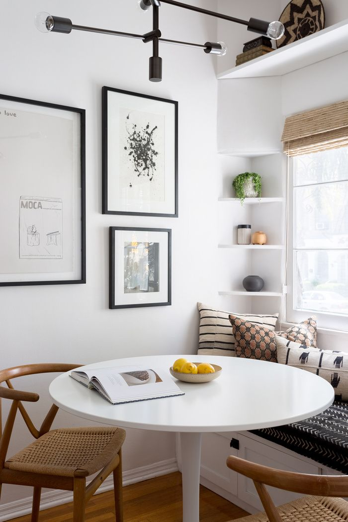 modern boho dining nook with round white table roman shade cushioned bench and black on boho chic kitchen table id=42304