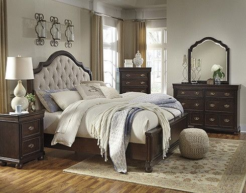 This bedroom is constructed with hardwood solids and Mindi veneers in rich brown cherry finish for a natural woody color. Dovetailed drawers have sealed drawer boxes and metal center guides. Cases set
