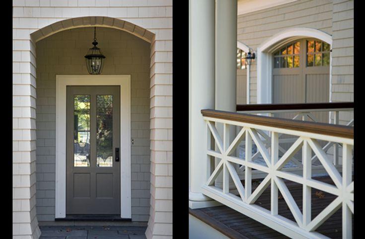 Porch railing - decorative panels.  Love the wood top.