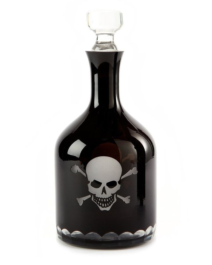 "This spooky decanter features a skull and crossbones hand-etched design on black glass. 100% Non-poisonous! Do you dare to give it a try? Sure to make any guest smirk with glee! Glass 11 1/2"" H x 5"" D"