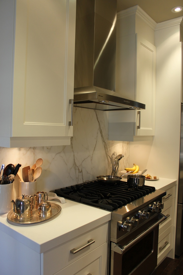 Solid Marble Backsplash With White Countertops And White Kitchen Cabinets For The Home