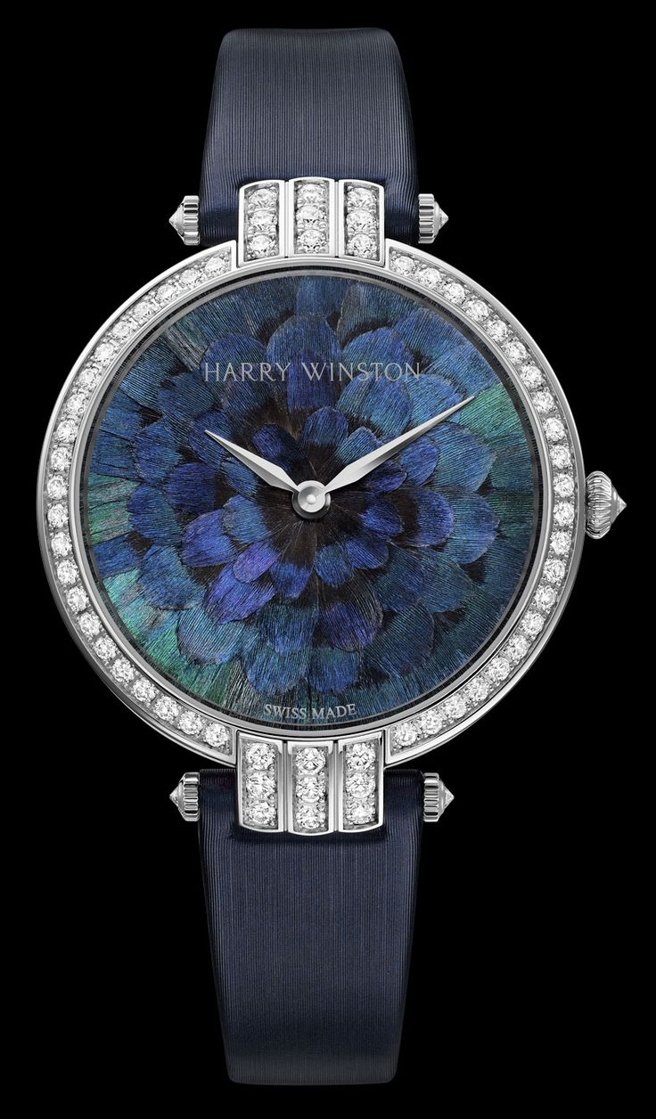The feather dials then are combined with the Cluster, the three-dimensional technique invented by Harry Winston himself which allows for the asymmetrical setting of pear, brilliant, and marquise-cut stones.