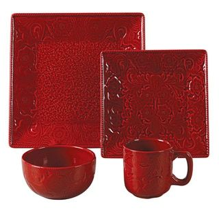 Enjoy this 16-piece dinnerware set with your family and friends. Constructed of ceramic and finished in black and red, this causal dish set includes dinner, and salad plates, soup bowls and mugs. Colo