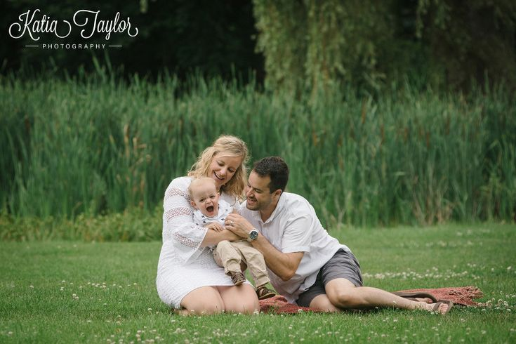 Parents with young son on a picnic blanket in Brueckner Rhododendron Park. Toronto Family Photography