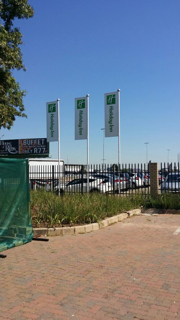 Holiday Inn Flags #hotel #signage #flags #advertisement