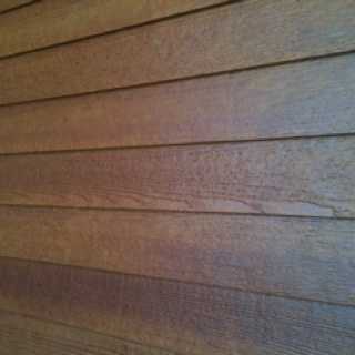 Faux wood siding roselawnlutheran for Wood grain siding panels