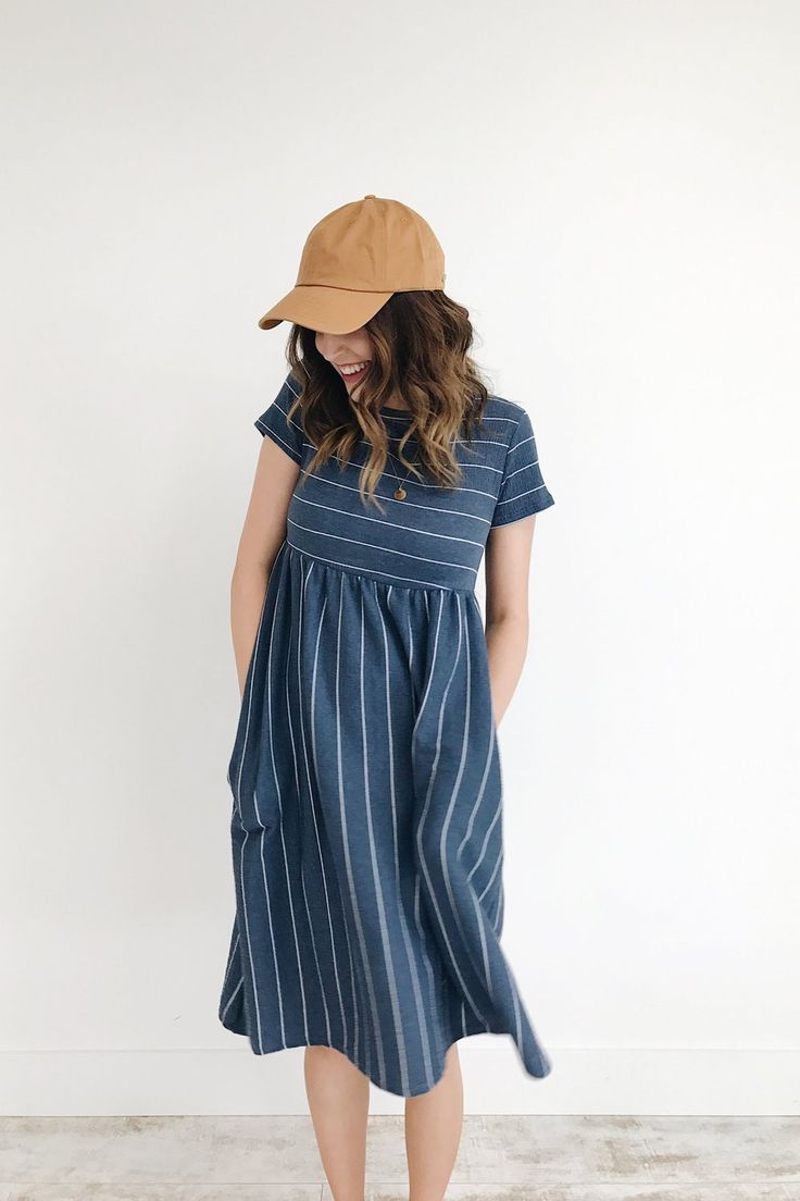 """Navy Blue + White Stripe Dress Short Sleeve w/Textured Top Hidden Side Pockets Also Available in Sky Blue Size Chart Model is 5'7"""" + Wearing a Small"""