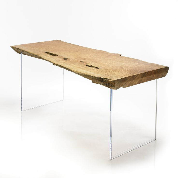 Kuma desk: Stunning floating tabletop. The Kuma desk is a beautiful, highly figured Western Maple slab, floating on clear acrylic legs. This desk has natural gaps in the tabletop, available to run laptop cables through - providing function in this beautiful art piece.
