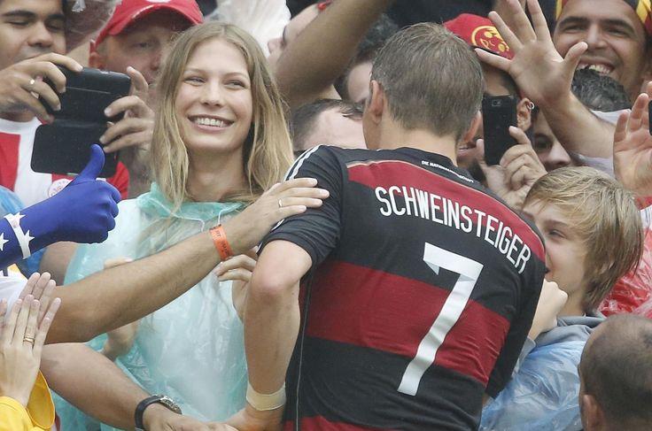 Bastian Schweinsteiger goes to kiss girlfriend Sarah Brandner