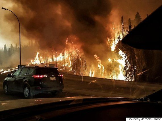 fort mcmurray   Residents flee Fort McMurray,Alberta as a massive wildfire enters the city in May 2016.