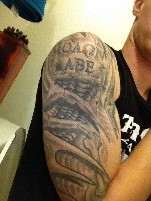 Biomech half sleeve over the tribal and molon labe my for Usmc sleeve tattoo ideas