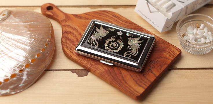 http://www.antiquealive.com/store/detail.asp?idx=4155 Mother of Pearl Cigarette Holder with Phoenix and Yin Yang Design