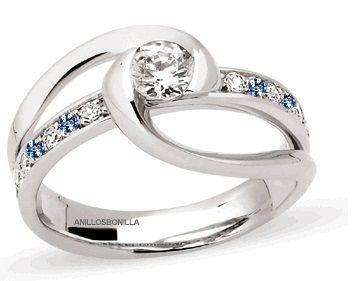 Anillo exclusivo en plata y oro con diamantes y zafiros