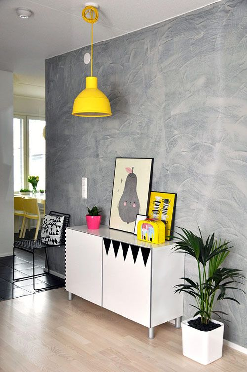 Bright yellow accents against grey walls. Nice feature for a hallway