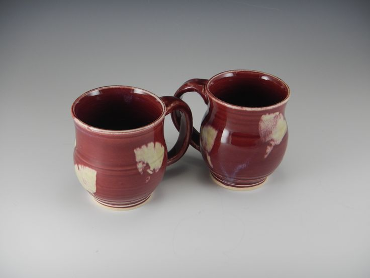 "Petite porcelain pair is a gorgeous dark red, with light ginkgo leaf pattern. 3.5"" tall."