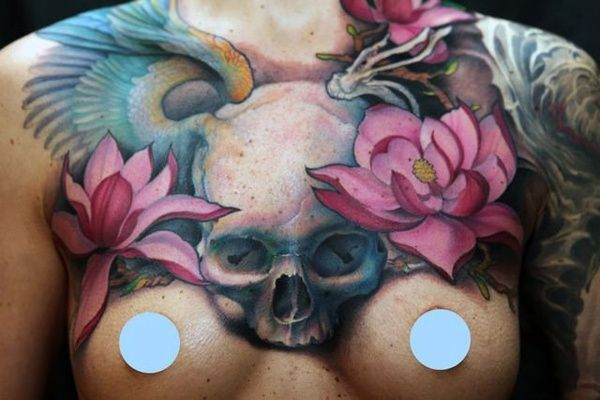 im not usually a fan of chest tattoos for women but this is amazing - by Jeff Gogue