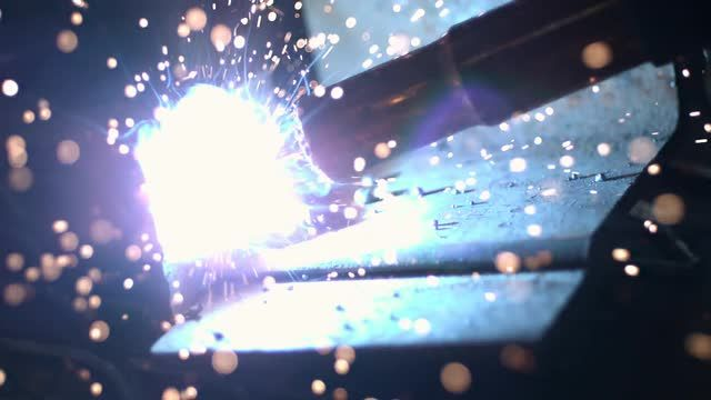 Slow motion of arc welder shooting sparks Stock Video Footage - VideoBlocks