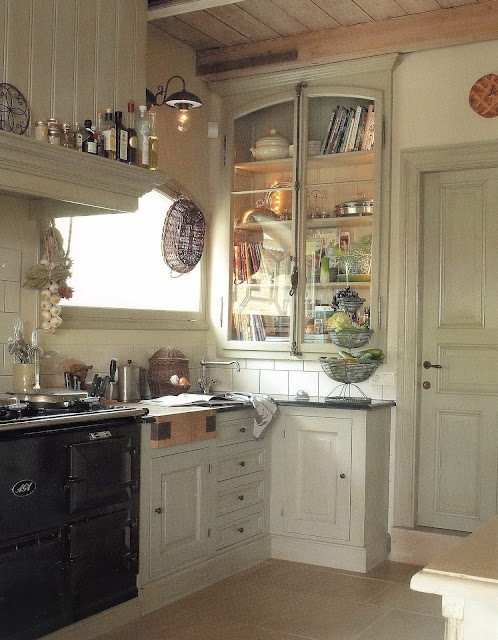 charming little kitchen - dark-grout white-tile, AGA, hood storage ledge, and best of all - cremone bolt cabinet