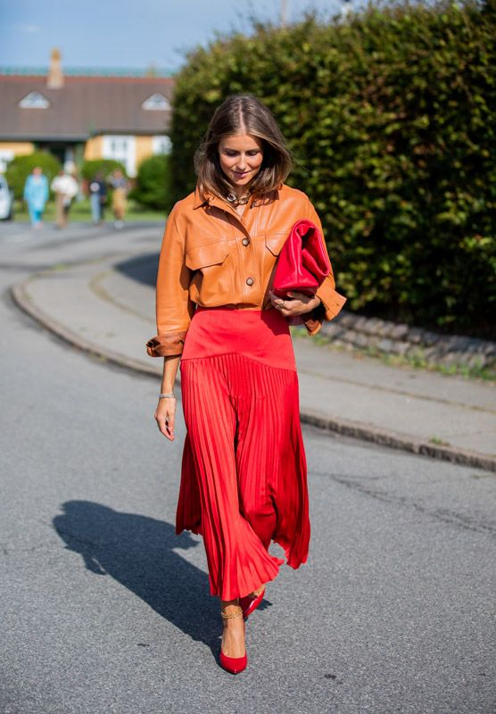 Nina Sandbech is seen wearing red pleated skirt, orange leather button shirt outside Stine Goya during Copenhagen Fashion Week Spring/Summer 2020 on August 2019 in Copenhagen, Denmark. Autumn Fashion Work, Fall Fashion Outfits, Modest Fashion, Fashion Top, Red Skirt Outfits, Red Skirts, Dress Red, Red Pleated Skirt, Orange