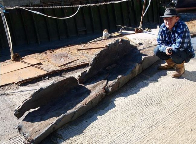 (SWAT Archaeology)KENT, ENGLAND—Kent Online reports that a log boat dating to the Bronze Age was discovered in a boatyard in the town of Faversham in southern England. A portion of the 4,000-year-old boat was lifted out of the water and Paul Wilkinson of SWAT Archaeology was called in to examine it