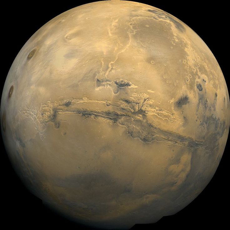 he largest canyon in the solar system, called Valles Marineris, cuts a wide swath across the face of Mars. The grand valley extends over 1,864 miles (3,000 kilometers long), up to 373 miles (600 km) across, and as much as (8 km) deep. The origin of the Valles Marineris remains unknown, although a leading hypothesis holds that it started as a crack billions of years ago as the planet cooled.