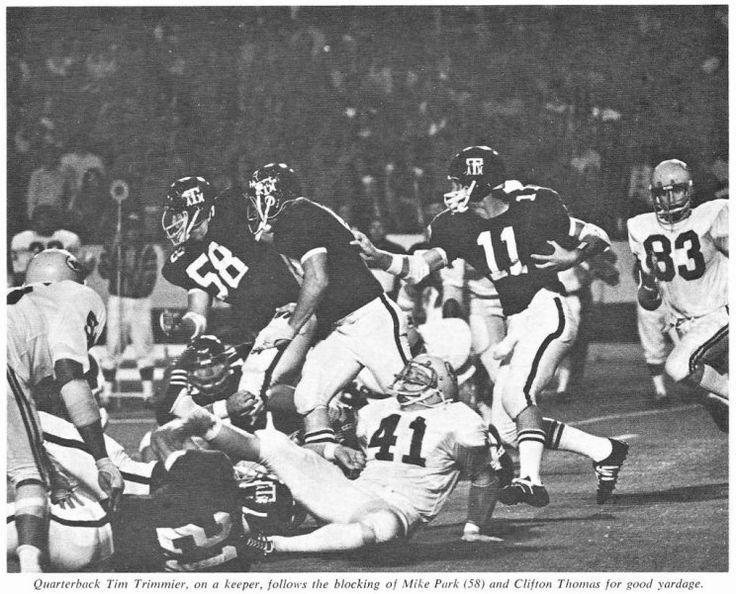 1971 Game Photo of Texas A & M quarterback Tim Trimmier (#11) follows Aggie lineman Mike Park & Clifton Thomas versus  Wichita State