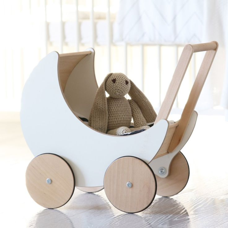 Wooden toy pram perfect for the toddlers to put their toys such as wooden blocks and dolls in! Great decorative item in the house!