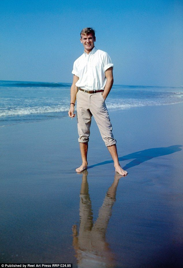 Beach walk: Tab Hunter embodies the Ivy Look in a shot from the mid-Fifties in which he po...