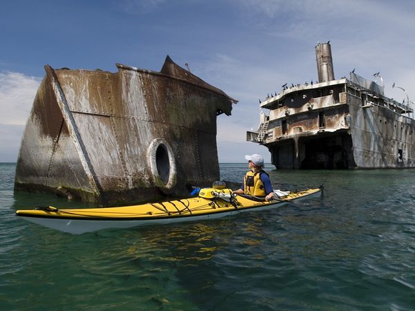 A sea kayaker paddles near the Francisco Morazan shipwreck at South Manitou Island in Sleeping Bear Dunes National Lakeshore near Traverse City. This pin takes you to a page detailing other sights to see in awesome Traverse City area.
