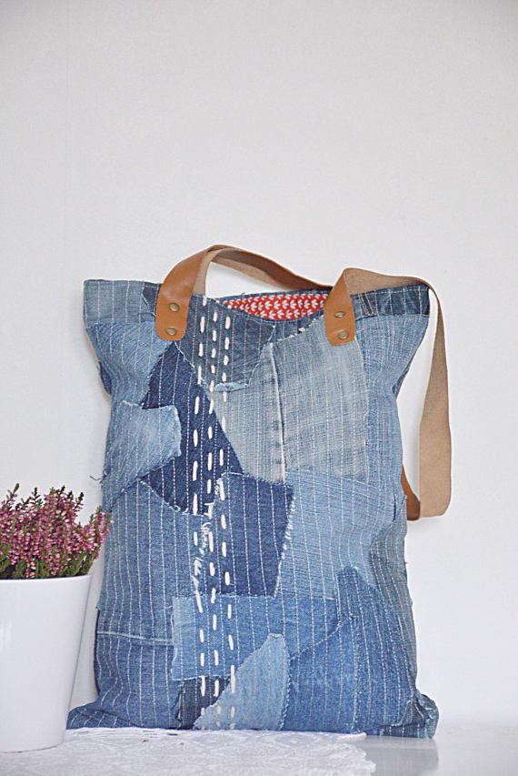 SASHIKO style denim tote bag with brown leather straps. Red cotton lining, denim pocket on the inside, pretty patchwork and detailed sashiko stiching make this bag truly a unique piece. This beautiful denim bag is made from high quality blue jeans (recycled - upcycled) with great