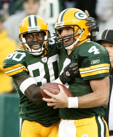 Green Bay Packers\' Brett Favre (4) and Donald Driver (80) celebrate after Driver caught a 33-yard touchdown pass in the third quarter against the Dallas Cowboys Sunday, Oct. 24, 2004, in Green Bay, Wis.