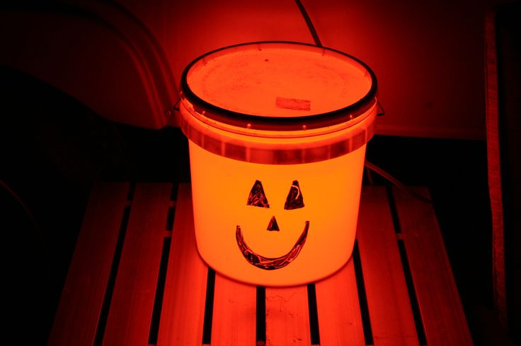 Bucket Light Jack-O-Lantern  Use an orange bulb and draw the face with a dry erase marker. Dry erase markers wipe off our bucket lights. This is great idea for those Fall camping trips.